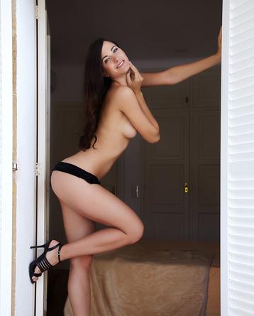 Posing in black high heels
