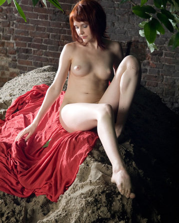 Redhead Girl Anelie Is Nude In The Garden