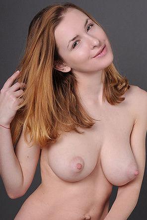 Big natural boobs pics by a redhead babe