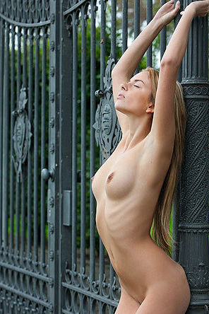 Sexy Stacey Posing By The Fence