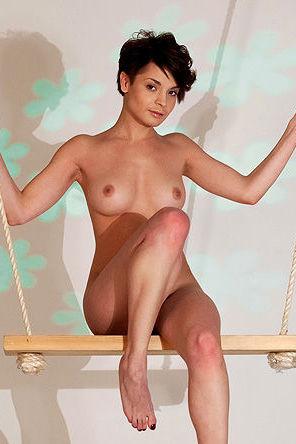 Lovely Brunette Girl Swinging In The Studio
