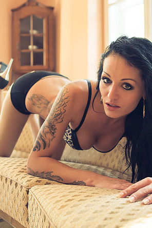 Tattooed Babe Posing In Lingerie