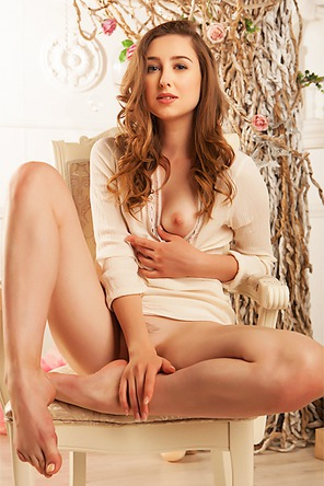 Silky skinned Ginger Frost is sitting serenely in her cream dress
