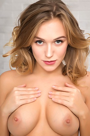 Beautiful blonde Aislin wastes no time in stripping out of her striped top